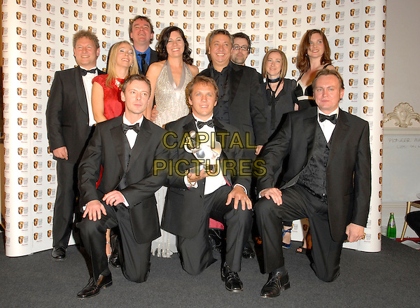 JOHN SIMM, PHILIP GLENISTER & cast of Life On Mars, winners of the Pioneer Audience Award.At The British Academy Television Awards (BAFTA) Sponsored by Pioneer, held at the London Palladium, London, England, May 20th 2007..full length press room trophies awards winners.CAP/FIN.©Steve Finn/Capital Pictures.