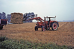 Tractor Lifting Hay Bale