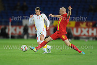 Cardiff City Stadium, Friday 11th Oct 2013. James Collins of Wales battles with Agim Ibraimi of Macedonia during the Wales v Macedonia FIFA World Cup 2014 Qualifier match at Cardiff City Stadium, Cardiff, Friday 11th Oct 2014. All images are the copyright of Jeff Thomas Photography-07837 386244-www.jaypics.photoshelter.com