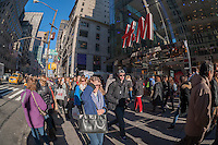 Crowds of tourists on Fifth Avenue in New York on the weekend after Christmas, Saturday, December 27, 2014. A sunny warm winter's day brought out thousands to shop and sight see, congesting the sidewalks. (© Richard B. Levine)