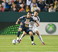 CARSON, CA – April 2, 2011: Philadelphia Union forward Carlos Ruiz (20) shields the ball from LA Galaxy defender Omar Gonzalez (4) during the match between LA Galaxy and Philadelphia Union at the Home Depot Center, March 26, 2011 in Carson, California. Final score LA Galaxy 1, Philadelphia Union 0.