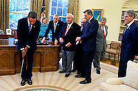 Washington, DC - September 30, 2009 -- United States President Barack Obama practices with a golf club after the signing ceremony for H.R. 1243, the Arnold Palmer Congressional Gold Medal Act, in the Oval Office, September 30, 2009. .Mandatory Credit: Samantha Appleton - White House via CNP/MediaPunch