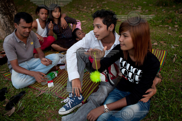 University students relax by a lake in Rangoon (Yangon).