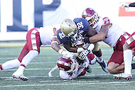 Annapolis, MD - December 3, 2016: Navy Midshipmen fullback Myles Swain (32) gets tackled by several Temple Owls defenders during game between Temple and Navy at  Navy-Marine Corps Memorial Stadium in Annapolis, MD.   (Photo by Elliott Brown/Media Images International)