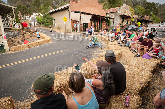 Kids and adults enjoy a great time during ACRA's (Amador County Recreation Agency) annual BIg Wheel races down the hills and onto Main Street, historic SR 49 in downtown Amador City at the conclusion of summer in early September.