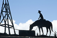 Iron carving of a cowboy on a horse