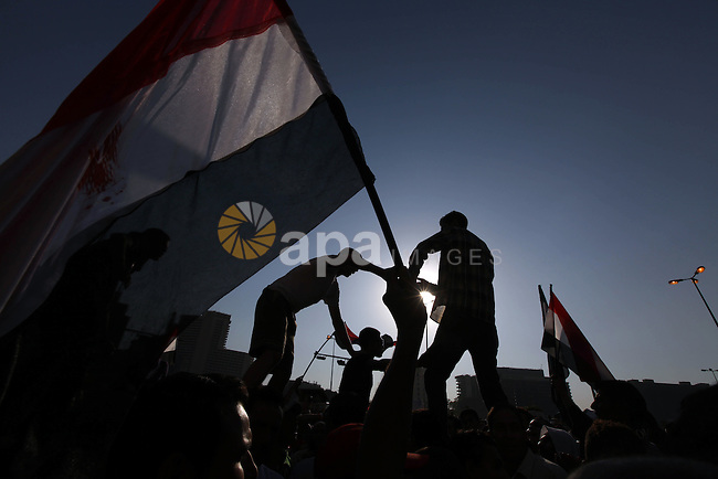 Protesters wave Egypt's flags during a demonstration at Tahrir square in Cairo, against the verdict for deposed leader Hosni Mubarak June 4, 2012. Egyptian pro-democracy campaigners called on Sunday for a new uprising, saying justice was not served by the trial of Mubarak and others blamed for the killing of protesters during the street revolt that ended his three-decade rule. Photo by  Majdi Fathi