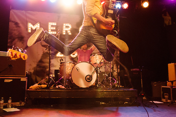 July 24, 2014. Carrboro, North Carolina.<br />  Superchunk frontman and MERGE Records co-founder Mac McCaughan leaps in the air during their Thursday night headlining set.<br />  Day two of the MERGE 25 festival, celebrating the 25 year history of the independent record label.