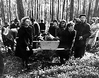 Civilians of Neunburg bear victims of SS killings to burial ground, after bodies were exhumed from mass grave where their murderers had dumped them.  Chaplains of U.S. Third Army will conduct burial services.  April 29, 1945.  Pfc. Wendell N. Hustead.  (Army)<br /> NARA FILE #:  111-SC-266656<br /> WAR &amp; CONFLICT BOOK #:  1125