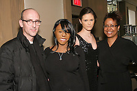 (L-R) Fashion designer R. Scott French, Linda Rowe Thomas, model, and guest pose backstage at the Romas by Linda Rowe Thomas Fall/Winter 2011 collection presentation, during New York Fashion Week.