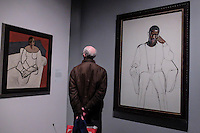 Visitor checks out paintings at The Met Breuer, a new outpost of the Metropolitan Museum of Art on Upper East Side  New York. 03.20.2016. Kena Betancur/VIEWpress.