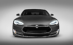 Gray 2017 Tesla Model S luxury electric car front view isolated on gray background with clipping path