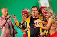 Picture shows : Tiziano Bracci as Mustafa (centre) with bunny girls and Paul Carey Jones as Haly (pink jacket)..Picture  ©  Drew Farrell Tel : 07721 -735041..A new Scottish Opera production of  Rossini's 'The Italian Girl in Algiers' opens at The Theatre Royal Glasgow on Wednesday 21st October 2009..(Soap) opera as you've never seen it before..Tonight on Algiers.....Colin McColl's cheeky take on Rossini's comic opera is a riot of bunny girls, beach balls, and small screen heroes with big screen egos. Set in a TV studio during the filming of popular Latino soap, Algiers, the show pits Rossini's typically playful and lyrical music against the shoreline shenanigans of cast and crew. You'd think the scandal would be confined to the outrageous storylines, but there's as much action off set as there is on.... .Italian bass Tiziano Bracci makes his UK debut in the role of Mustafa. Scottish mezzo-soprano Karen Cargill, who the Guardian called a 'bright star' for her performance as Rosina in Scottish Opera's 2007 production of The Barber of Seville, sings Isabella. .Cast .Mustafa...Tiziano Bracci.Isabella..Karen Cargill.Lindoro...Thomas Walker.Elvira...Mary O'Sullivan.Zulma...Julia Riley.Haly...Paul Carey Jones.Taddeo...Adrian Powter. .Conductors.Wyn Davies.Derek Clarke (Nov 14). .Director by Colin McColl.Set and Lighting Designer by Tony Rabbit.Costume Designer by Nic Smillie..New co-production with New Zealand Opera.Production supported by.The Scottish Opera Syndicate.Sung in Italian with English supertitles..Performances.Theatre Royal, Glasgow - October 21, 25,29,31..Eden Court, Inverness - November 7. .His Majesty's Theatre, Aberdeen  - November 14..Festival Theatre,Edinburgh - November 21, 25, 27 ...Note to Editors:  This image is free to be used editorially in the promotion of Scottish Opera. Without prejudice ALL other licences without prior consent will be deemed a breach of copyright under the 1988. Copyright Design and Patents Act  and will be subject to payment or