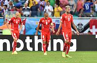 FUSSBALL WM 2014  VORRUNDE    GRUPPE E     Schweiz - Frankreich                   20.06.2014 Philippe Senderos, Goekhan Inler und Valon Behrami (v.l., alle Schweiz) sind enttaeuscht