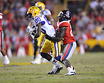 LSU wide receiver Jarvis Landry (80) is tackled by Ole Miss defensive back Senquez Golson (21) at Tiger Stadium in Baton Rouge, La. on Saturday, November 17, 2012. LSU won 41-35.....