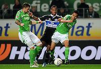 FUSSBALL   1. BUNDESLIGA   SAISON 2011/2012   27. SPIELTAG VfL Wolfsburg - Hamburger SV         23.03.2012 Marco Russ (li) und Makoto Hasebe (re, beide VfL Wolfsburg) gegen Dennis Aogo (re, Hamburger SV)