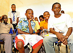 Hatua Likoni Foundation high school scholarship students marvel at a slide show of their photographs during a Sunday afternoon photography workshop co-sponsored by the Foundation and New York photographer Todd Shapera..  The workshop used cameras from U.S. donors.