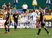 Steven Lenhart (24) of the San Jose Earthquakes celebrates his first goal with teammates during the game at RFK Stadium in Washington, DC.  D.C. United was defeated by the San Jose Earthquakes, 4-2.