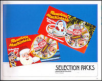 BNPS.co.uk (01202 558833)<br /> Pic: Nestle/BNPS<br /> <br /> ***Please use full byline***<br /> <br /> A box from 1981<br /> <br /> A fascinating archive of vintage selection boxes have emerged to reveal how the common stocking filler was once a luxurious present that families would save all year for.<br /> <br /> The assorted chocolate packs were launched by Rowntrees in the 1920s after the success of their Christmas hampers.<br /> <br /> They were considered as extremely extravagant gifts with an early box from 1927 costing 10 shillings, the equivalent of one weeks rent for a poor, working class family.<br /> <br /> The boxes contained some of the first chocolate bars invented by the company that are no longer in existance, including Nut Cracknel, Cream Tablette, and Motoring bars.<br /> <br /> Families began putting aside money throughout the year to afford the must-have gifts, which became more extravagant as their popularity grew.<br /> <br /> Rowntrees provided newsagents and grocery shops with special Christmas Club Cards which buyers used to pay weekly installments towards the selection boxes.<br /> <br /> In the 1930s Rowntrees began adding novelty items to the packs such as vases, carriage clocks, and cutlery sets, which acted as keepsakes once the chocolate had been eaten.<br /> <br /> They ranged in price from 2 shillings and six pence up to 10 shillings depending on the size of the enclosed gift.