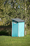 Teal painted outhouse
