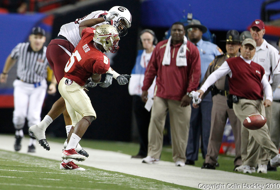 ATLANTA, AG 12/31/10-FSU-SC FB10 CH-Florida State's Greg Reid collides with South Carolina's Tori Gurley breaking up a pass late in the fourth quarter Friday at the Chick-fil-A Bowl in Atlanta. The Seminoles beat the Gamecocks 26-17..COLIN HACKLEY PHOTO