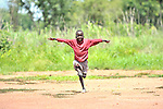 A boy in the village of Luena, in the Democratic Republic of the Congo, is inspired to attempt flight by the presence of a plane from the Wings of the Morning aviation ministry of The United Methodist Church.