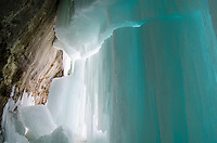 A massive blue column of ice with a giant crack passing through it. Grand Island Ice Caves, Munising, MI