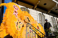 "Wallace Pardo, ""Chief"" of the Golden Comanches Mardi Gras Indians, emerges from a house in New Orleans on February 28, 2006."
