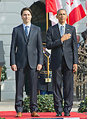 United States President Barack Obama, right, and Prime Minister Justin Trudeau of Canada, left, listen to the National Anthems during an Arrival Ceremony on the South Lawn of the White House in Washington, DC on Thursday, March 10, 2016. <br /> Credit: Ron Sachs / CNP