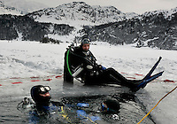 Athletes looking for challenges are drawn to extreme sports like ice diving.  A hole is cut in the ice by the local St Moritz police, but at night a foot of ice forms over it and in the morning the hole has to be reopened. <br /> <br /> Some photographs of ski lessons in town of  Maloja  near St. Moritz..Also ice diving.