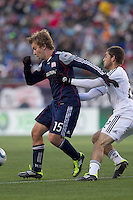 New England Revolution forward Zack Schilawski (15) attempts to control the ball. In a Major League Soccer (MLS) match, the New England Revolution defeated DC United, 2-1, at Gillette Stadium on March 26, 2011.