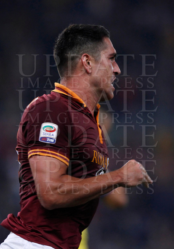 Calcio, Serie A: Roma vs ChievoVerona. Roma, stadio Olimpico, 31 ottobre 2013.<br /> AS Roma forward Marco Borriello celebrates after scoring during the Italian Serie A football match between AS Roma and ChievoVerona at Rome's Olympic stadium, 31 October 2013.<br /> UPDATE IMAGES PRESS/Isabella Bonotto