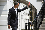 President Barack Obama waves to members of the public as he departs the White House for Chicago on Saturday, August 11, 2012 in Washington, DC.
