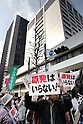 April 10, 2011, Tokyo, Japan - Carrying placards and banners reading Nukes, frustrated Tokyo residents make their feelings clear in anti-nuclear protests in front of Tokyo Electric Power Company on Sunday, April 10, 2011. Some 15,000 people took to the streets in Tokyo in two separate protest against TEPCO, the operator of the crippled nuclear plant in Fukushima, some 200 km northeast of Tokyo. (Photo by AFLO) [3609] -mis-