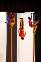 Pole climbers in Chinese acrobatic show, Beijing, China, Asia