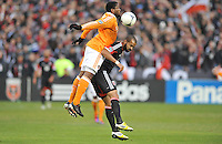 D.C. United forward Santos Maicon (29) heads the ball against Houston Dynamo Defender Jarmaine Taylor (4) D.C. United tied The Houston Dynamo 1-1 but lost in the overall score 4-2 in the second leg of the Eastern Conference Championship at RFK Stadium, Sunday November 18, 2012.