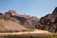 Phantom Ranch finally in sight on a hot summer day (114?). Park Service Helicopter and hiker on the Silver bridge crossing the Colorado river.