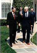 United States President Ronald Reagan escorts Ambassador Anatoly Fyodorovich Dobrynin of the Soviet Union following their meeting in the Oval Office on Tuesday, April 8, 1986.  Behind the President and the Ambassador are: Soviet DCM Oleg Sokolov, center, and Soviet Deputy Minister Aleksandr Bessmertnykh, right..Mandatory Credit: Bill Fitz-Patrick - White House via CNP
