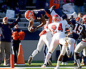 December 5, 2009 - Champaign, Illinois, USA -  Illinois running back Mikel Leshoure (5) leaps for a touchdown in the game between the University of Illinois and Fresno State at Memorial Stadium in Champaign, Illinois.  Fresno State defeated Illinois 53 to 52..