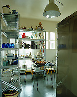 In the kitchen a pair of industrial-style stainless steel shelving units is a stylish and practical storage solution