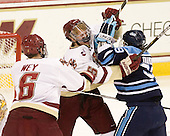 Philip Samuelsson (BC - 5) battles with Joey Diamond (Maine - 39) in front of the BC crease. - The Boston College Eagles defeated the visiting University of Maine Black Bears 4-1 on Sunday, November 21, 2010, at Conte Forum in Chestnut Hill, Massachusetts.