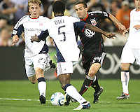 Brandon Barklage #24 of D.C. United tries to break past Emmanuel Osei #5 and Seth Sinovic #27 of the New England Revolution during an MLS match on April 3 2010, at RFK Stadium in Washington D.C.