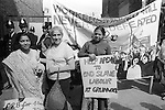 Grunwick Strike North London UK.  South asian women strikers Mrs Desai on left with banner that reads £28-00 for a 40 hour weeks.