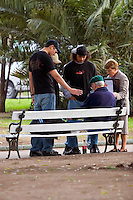 South America, Argentina, Almirante Brown, Adrogue, Evangelism - International missionaries along with locals evangelize on the streets of Adrogue, July 2006, &copy;Stephen Blake Farrington<br />