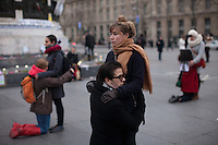 Two people take part in a silent tribute to Shaimaa El-Sabagh at Place de la République, who was shot dead by police at a march organized by her leftist party, called Popular Alliance, in Cairo, Egypt on Saturday January 24th. Photos widely distributed show Shaimaa El-Sabagh, bloody, held up by a fellow protestor following the shooting. Paris, France. Jan. 27, 2015.