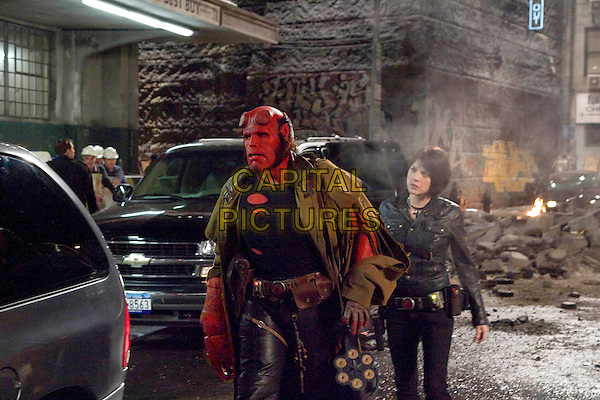 """The world's toughest, kitten-loving hero from Hell, Hellboy (RON PERLMAN), and his girlfriend, the pyrokinetic Liz (SELMA BLAIR), in the next chapter of the franchise known for its signature blend of action, humor and character-based spectacle--""""Hellboy II: The Golden Army""""."""