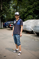 Lindujun, a student, age 23, poses for a portrait in Nanjing. Response to 'What does China mean to you?': 'Ancient and mysterious country.'  Response to 'What is China's role in the future?': 'A beautiful lion profoundly sleeping.'
