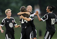 BOYDS, MARYLAND-JULY 07,2012:  Marisa Abegg (5) of DC United Women with Andi Sullivan (24) after Sullivan had scored the third goal against the Dayton Dutch Lions during a W League game at Maryland Soccerplex, in Boyds, Maryland. DC United women won 4-1.