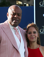 """HOLLYWOOD, CA - May 18: Chi McBride, Julissa Mcbride, At Premiere Of Disney's """"Pirates Of The Caribbean: Dead Men Tell No Tales"""" At Dolby Theatre In California on May 18, 2017. Credit: FS/MediaPunch"""