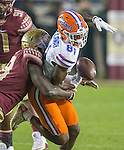 Florida State linebacker Ro'Derrick Hoskins strips the ball from Florida wide receiver Calloway Antonio in the first half of an NCAA college football game in Tallahassee, Fla., Saturday, Nov. 26, 2016. Florida State defeated Florida 31-13. (AP Photo/Mark Wallheiser)